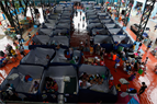 Evacuees at a temporary shelter in Marikina City, east of Manila, on Saturday. More than 100,000 have fled their homes across the Philippines